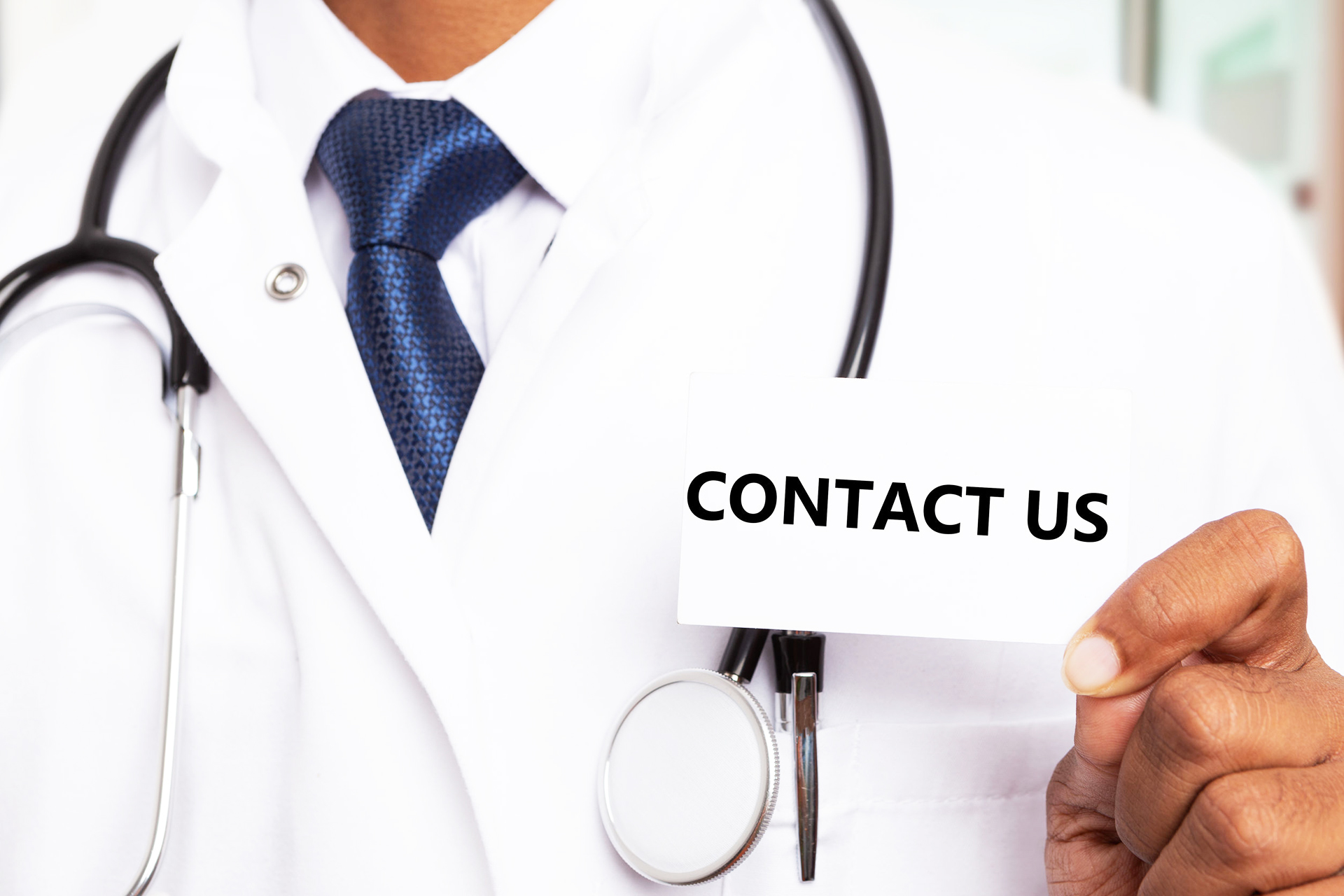 doctor presenting close-up of contact us text on white business card